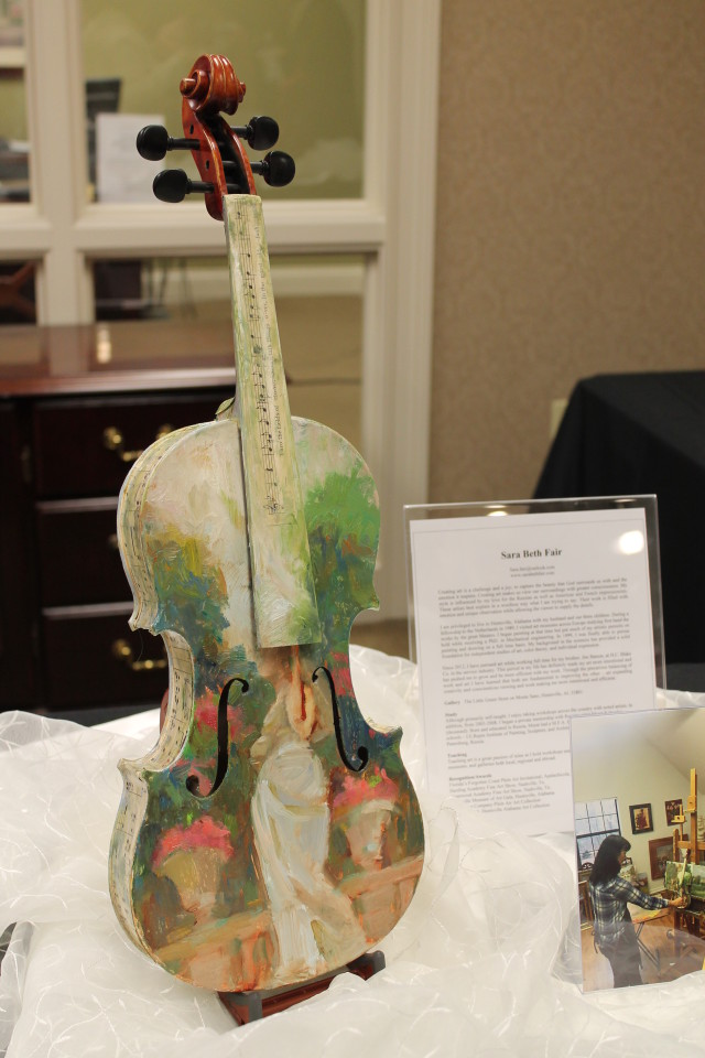 Violin painted by Huntsville artist Sara Beth Fair. (Inspired by her love of and trips to Paris.)