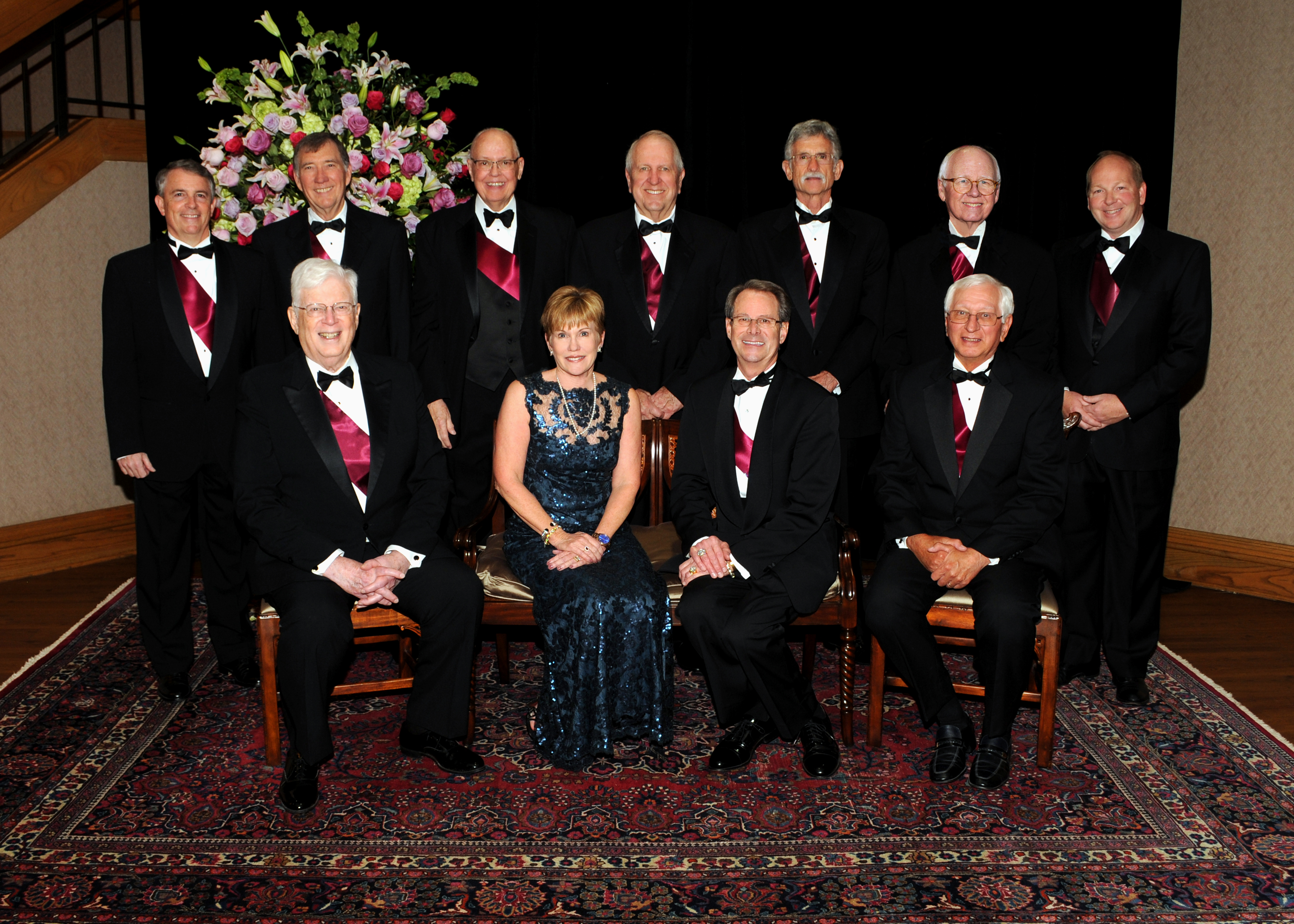 Symphony Ball Advisors: Row 1 (seated left to right) Dr. Steven Smith, Linda Akenhead (Ball Chair), Randy Roper, Dr. Doug Patz, | Row 2 (standing left to right) Warne Heath, Dr. John Cox, Dan Halcomb, John Switzer, Larry Thomas, Byrd Latham, Michael Timberlake